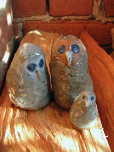 "Lazy Grey Owl Family ; Stoneware ; Tallest totem stands 3"", smallest just over 1"""